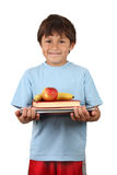 Schoolboy with fruit and books stock photo
