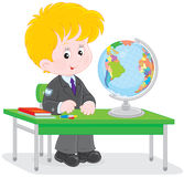 Schoolboy at geography lesson Royalty Free Stock Images