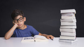 Schoolboy gets bored learning stock image
