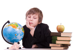 Schoolboy with globe, books and apple royalty free stock photos