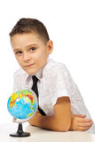 Schoolboy with a globe Stock Photos