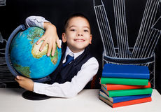 Schoolboy with a globe Stock Photography