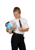 Schoolboy with globe royalty free stock photo