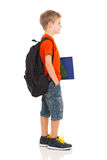 Schoolboy going to school. Happy schoolboy going to school isolated on white Royalty Free Stock Photos