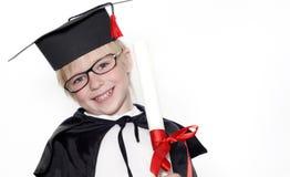 Schoolboy in graduation cap Stock Photos