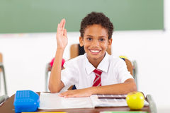 Schoolboy hand up. Cute primary schoolboy hand up in classroom Royalty Free Stock Photo