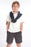 Schoolboy with hands in pockets Stock Photography