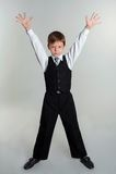 Schoolboy hands up Stock Photos