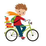 Schoolboy. Happy boy going to school by cycle Royalty Free Stock Image