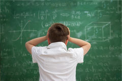 Schoolboy have problem with  formulas Stock Image