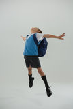 Schoolboy having fun against white background Royalty Free Stock Images