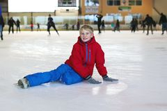 Schoolboy having fun on ice skating rink Stock Images