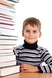 Schoolboy and a heap of books Stock Image