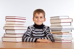 Schoolboy and a heap of books Royalty Free Stock Photography