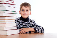 Schoolboy and a heap of books Royalty Free Stock Image