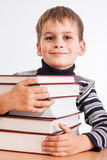Schoolboy and a heap of books Stock Photos
