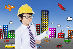 Schoolboy with helmet and blueprint Royalty Free Stock Image