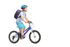 Schoolboy with a helmet riding a bike Stock Images
