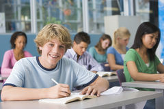 Schoolboy in high school class Stock Photography