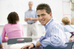 A schoolboy in a high school class royalty free stock image