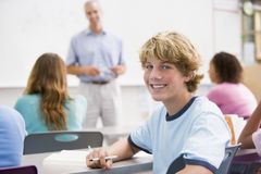 A schoolboy in a high school class royalty free stock photo