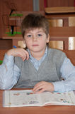 Schoolboy at his desk in the classroom Royalty Free Stock Photo