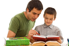 Schoolboy and his father learning Stock Photography