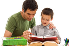 Schoolboy and his father learning Stock Photo