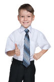 Schoolboy with his thumb up Stock Photo