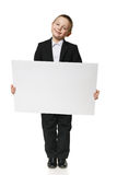 Schoolboy holding blank banner Royalty Free Stock Photos