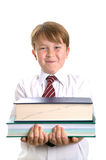 Schoolboy holding books Stock Photography