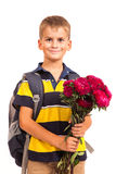 Schoolboy is holding flowers. Back to school Royalty Free Stock Photo