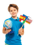 Schoolboy holding a globe and different flags Royalty Free Stock Photo