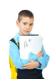 Schoolboy holding good test result. School boy holding good test result with A + isolated on white background stock images