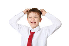 Schoolboy holding his head, isolated in white background. Stress Royalty Free Stock Photography