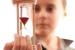 Schoolboy holding a hourglass Royalty Free Stock Photo