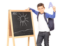 Schoolboy holding the letter a Royalty Free Stock Photo