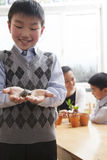 Schoolboy holding a little turtle in his hands, Beijing Stock Images