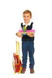Schoolboy holding notebooks and pencils Royalty Free Stock Photography