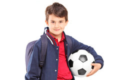 Schoolboy holding a soccer ball Royalty Free Stock Image