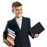 Schoolboy holding a tablet and books Royalty Free Stock Photo