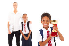 Schoolboy holding trophy Stock Photo