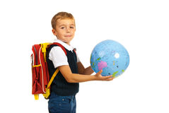 Schoolboy holding world globe Royalty Free Stock Photos