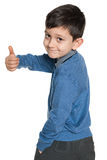 Schoolboy holds her thumb up Stock Photo