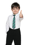 Schoolboy holds his thumb up Royalty Free Stock Photography
