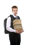 The schoolboy with a huge pack of books Royalty Free Stock Image