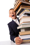 Schoolboy with huge stack of books Stock Photo