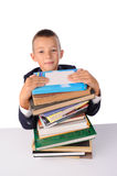 Schoolboy with huge stack of books Stock Photos