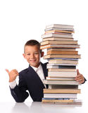 Schoolboy with huge stack of books Stock Image