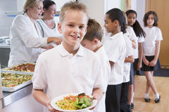 Schoolboy In A School Cafeteria Stock Photography